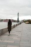 Girls walking away. On the bank of Moscow-river royalty free stock photos