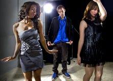 Girls Walking Away from Broke Man at a Nightclub Royalty Free Stock Photos