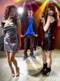 Girls Walking Away from Broke Man at a Nightclub Stock Photos