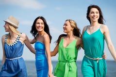 Girls walking on the beach Royalty Free Stock Image