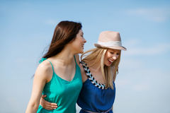 Girls walking on the beach Royalty Free Stock Photo