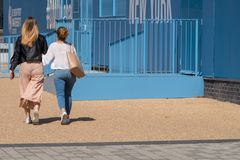 Girls walking through de monfort university on sunny day Stock Photo