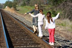 Girls walking on railroad tracks Stock Images