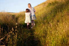 Girls walking up a hill Royalty Free Stock Photography