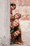 Girls on the wall Royalty Free Stock Images