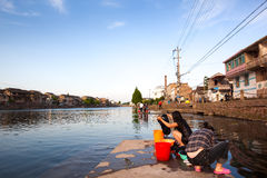 Girls washing clothes in china township Stock Images