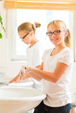 Girls are washing hands in the bath Royalty Free Stock Images
