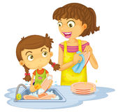 A girls washing plates Stock Photo