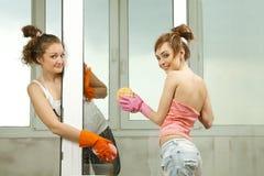 Free Girls Washing The Window Royalty Free Stock Photo - 19612145