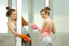 Girls washing the window Royalty Free Stock Photo