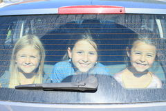 Girls watching from car trunk Royalty Free Stock Image
