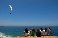 Girls Watching Parachutist. Group of girls watching a parachuter in San Diego Stock Image