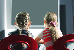 Girls watching television Stock Image