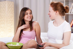 Girls watching tv and talking Stock Image