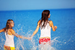 Girls in water Stock Images