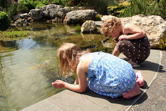Girls by Water Stock Photography
