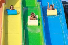 Girls on the water slide Royalty Free Stock Photo