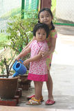 Girls watering plant Royalty Free Stock Photo