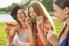 Girls with watermelon Stock Images