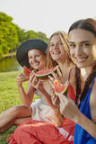Girls with watermelon Stock Image