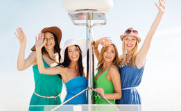 Girls waving on boat or yacht Royalty Free Stock Image