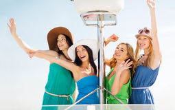 Girls waving on boat or yacht Royalty Free Stock Photo