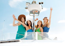 Girls waving on boat or yacht Royalty Free Stock Photos