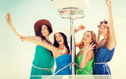 Girls waving on boat or yacht Royalty Free Stock Images