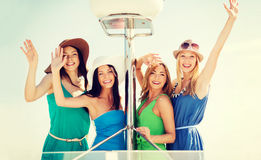 Girls waving on boat or yacht Stock Image