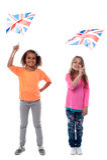 Girls waving United Kingdom flags Stock Images