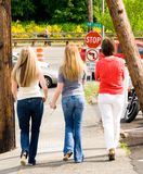 Girls on the way to the park Stock Images