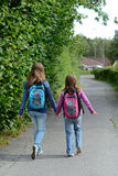 Girls on the way to school Stock Images