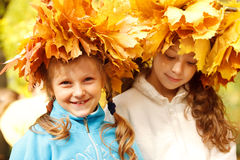 Girls wearing autumnal head wreaths Royalty Free Stock Photography