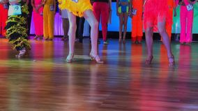 Girls wearing colourful dresses take part in competitions. Girls wearing colourful dresses take part in dance competitions. Slow motion stock video