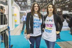 Girls wearing Expo t-shirt at Bit 2015, international tourism exchange in Milan, Italy. MILAN, ITALY - FEBRUARY 13: Girls wearing Expo t-shirt at Bit Royalty Free Stock Photos