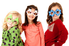 Girls wearing funny glasses with christmas theme Royalty Free Stock Image
