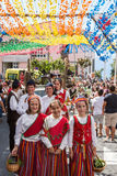 Girls wearing in traditional costumes at Madeira Wine Festival in Estreito de Camara de Lobos, Madeira, Portugal. Royalty Free Stock Image