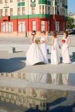 Girls in a wedding dresses Stock Photos