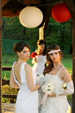 Girls in a wedding dresses Royalty Free Stock Photography