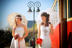 Girls in a wedding dresses Royalty Free Stock Image