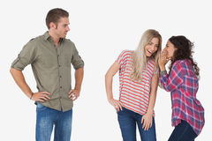 Girls whispering secrets and leaving man out Stock Images