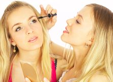 Girls on a white background. Make-up. Royalty Free Stock Image