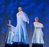 Girls in white dresses dancing on stage, Russian National Dance Stock Image