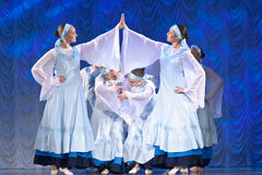 Girls in white dresses dancing on stage, Russian National Dance Royalty Free Stock Photos