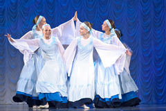 Girls in white dresses dancing on stage, Russian National Dance Stock Photography