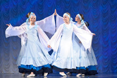 Girls in white dresses dancing on stage, Russian National Dance. Festival for children and youth dance groups, St. Petersburg, Russia royalty free stock image