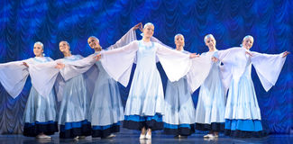 Girls in white dresses dancing on stage, Russian National Dance Royalty Free Stock Images