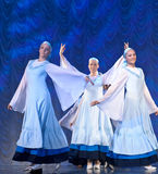 Girls in white dresses dancing on stage, Russian National Dance Royalty Free Stock Image