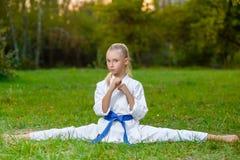 Girls in white kimono during training karate Royalty Free Stock Photos