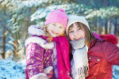 girls in winter forest Stock Photo